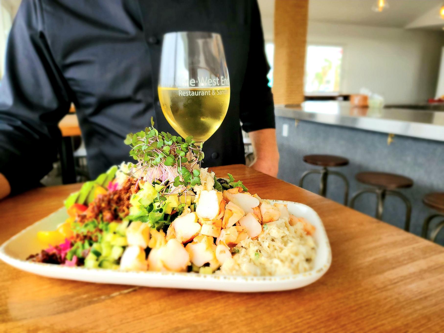 chef aldis west end marina and restaurants cobb salad and chardonnay